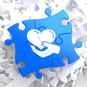 Charity Concept - Icon of Heart in the Hand - Located on Blue Puzzle Pieces. Social Background.-1